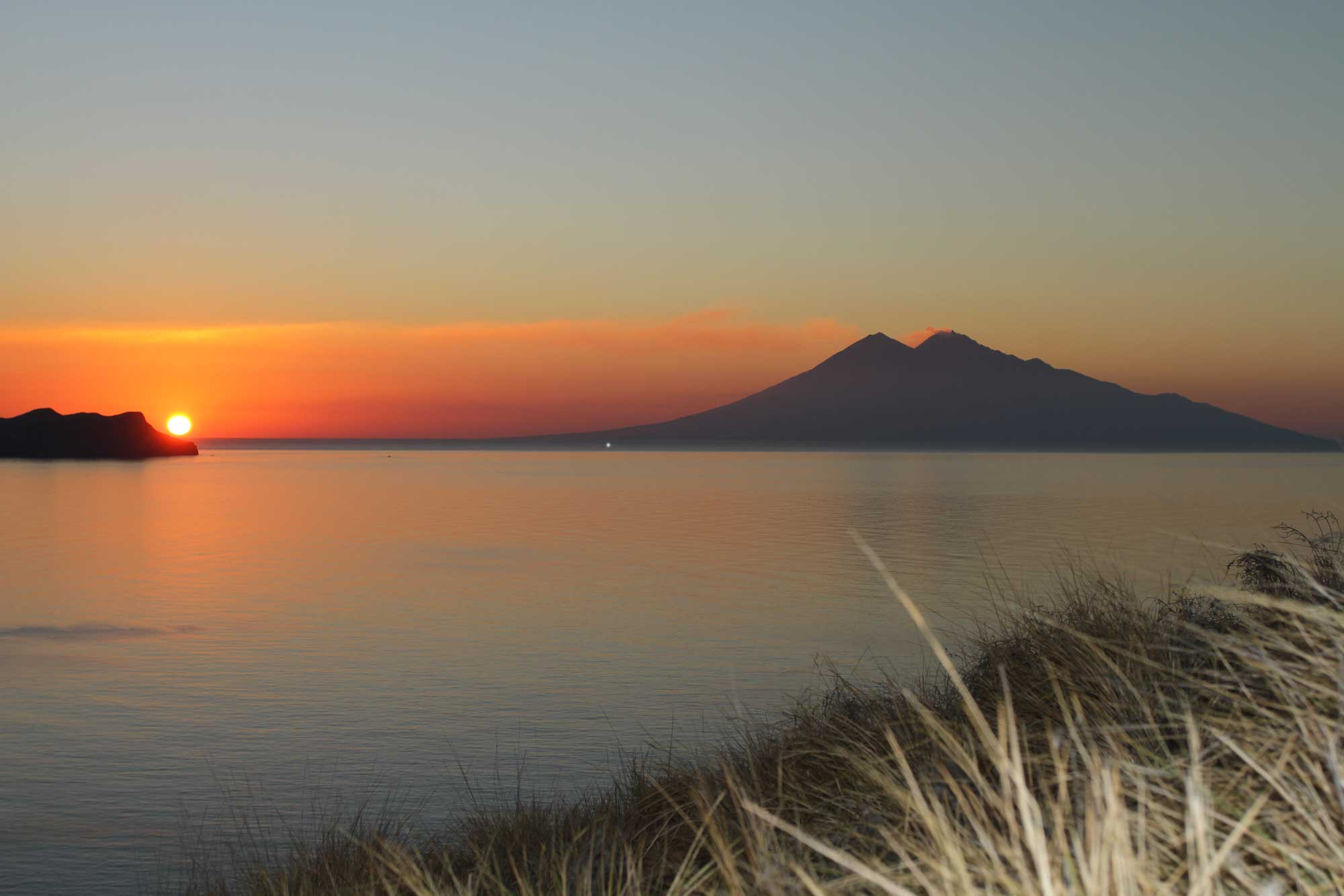 philosophy cruising indonesia sangeang volcano sunset komodo